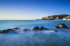 Rocks in a blue ocean on sunset. Castiglioncello, Tuscany Italy Stock Photo