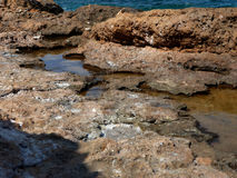 Rocks. By the blue sea Stock Photography
