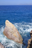 Rocks in blue sea Royalty Free Stock Image