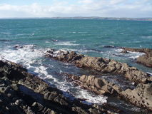 Rocks by blue sea, Ireland Royalty Free Stock Photography