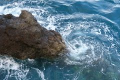 Rocks in the blue sea, madeira in winter stock photo
