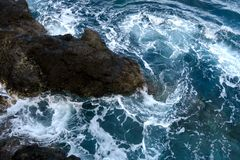 Rocks in the waves, madeira royalty free stock photo