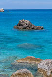 Rocks in the Blue waters of Ionian sea Stock Images