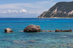 Rocks in the Blue waters of Ionian sea, near Agios Nikitas village Stock Images