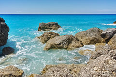 Rocks in the blue waters of Megali Petra Beach, Lefkada, Greece Stock Photo