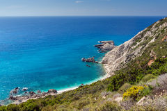 Rocks and blue waters near Petani Beach, Kefalonia, Greece Stock Photo