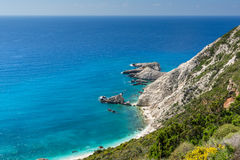 Rocks and blue waters near Petani Beach, Kefalonia, Greece Royalty Free Stock Photo