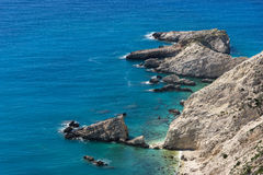 Rocks and blue waters near Petani Beach, Kefalonia, Greece Royalty Free Stock Images
