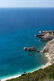 Rocks and blue waters near Petani Beach, Kefalonia, Greece Stock Images