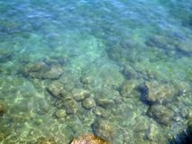 Rocks blurred background. Rock in the water royalty free stock photos