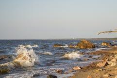 Rocks breaking waves. At beach Stock Photos