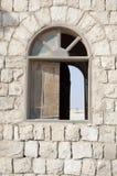 Rocks Building Window Stock Photo