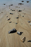 Rocks Buried in Sand Royalty Free Stock Photography