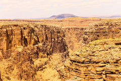 Rocks and Canyon. Overlook of the Little Colorado River gorge. Different rock layers can be seen aswell as loose rocks on the canyon walls Royalty Free Stock Images