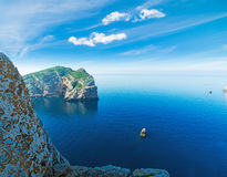 Rocks in Capo Caccia bay with Foradada island on the background Royalty Free Stock Images