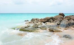 Rocks in the caribbean sea on Aruba island Royalty Free Stock Photos