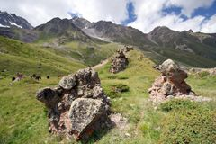 Rocks in Caucasus mountain valley with grass Royalty Free Stock Photography