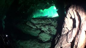Rocks in a cave of Yucatan cenotes underwater caves in Mexico. Natural landscape in clean and clear underground water in reflection of sunlight stock video footage