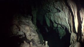 Rocks in a cave of Yucatan cenotes underwater caves in Mexico. Natural landscape in clean and clear underground water in reflection of sunlight stock video