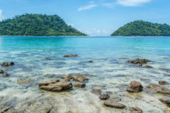 Rocks in the clear beautiful sea at Lipe Island in Thailand. Beautiful Sea with rocks in the sea at lipe island in Thailand royalty free stock images