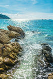 Rocks in the clear beautiful sea at Lipe Island in Thailand. Rocks and coral under the sea at Lipe Island in Thailand stock photography