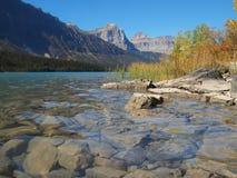 Rocks in clear mountain lake , Alberta Canadian rockies Royalty Free Stock Photo