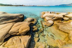 Rocks and clear water in Spiaggia del Riso in Villasimius. Sardinia, Italy royalty free stock image