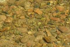 Rocks in clear water royalty free stock images
