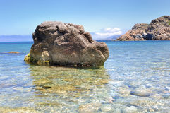 Rocks in clearful sea Stock Photo