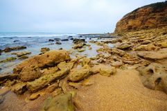 Rocks, cliff and beach Royalty Free Stock Photos