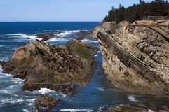 Rocks and Cliffs at Coo's Bay, Oregon Stock Photo