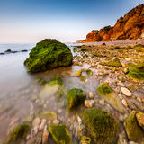 Rocks and Cliffs of Porto de Mos Beach in the Morning, Lagos Stock Photography