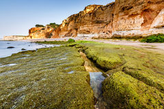 Rocks and Cliffs of Porto de Mos Beach in the Morning, Lagos Royalty Free Stock Image