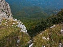Rocks and cliffs on trekking path at Suva Planina mountain Royalty Free Stock Photo