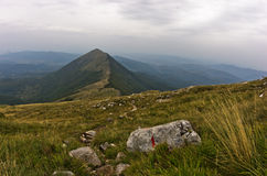 Rocks and cliffs under dark clouds trekking path at Suva Planina mountain Royalty Free Stock Photo