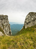 Rocks and cliffs under dark clouds trekking path at Suva Planina mountain Stock Image