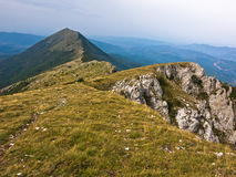 Rocks and cliffs under dark clouds trekking path at Suva Planina mountain Stock Photography
