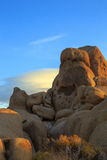 Rocks and clouds. Unique rock formation and lenticular clouds behind it at Joshua tree national park, California Stock Photo