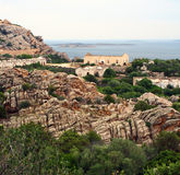 Rocks on the coast. Rocks and a ruin on the coast in Sardinia stock photos