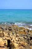Rocks on the coast of Aegean Sea. Stock Photos