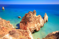 Rocks at the coast of Alvor Portugal. Rocks at Beach Tres Imaos between Portimao and Alvor Stock Photos