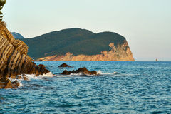 Rocks on the coast. Rocks breaks in the sea in the Petrovac town, Montenegro Stock Images