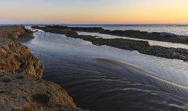 Rocks on the coast of the Caspian Sea near Baku at sunrise.Azerb Royalty Free Stock Photography