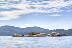 Rocks at the coast. Rocks in the ocean at the coast of Ilha Grande, Brazil Stock Image