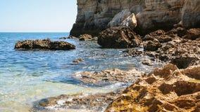 Rocks on coastline of beach Praia Maria Luisa. Travel to Algarve Portugal - coquina rocks on coastline of beach Praia Maria Luisa near Albufeira city in sunny Stock Photos