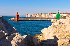 Rocks and colorful  architecture details at Piran harbor, Istria Stock Photography