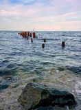 Seascape with rocks and columns. Rocks and columns on a sea Stock Images