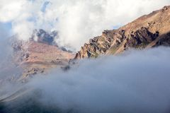 Rocks covered by clouds. Tien Shan Stock Photography