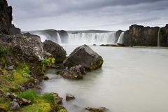 Rocks covered with grass and moss at Godafoss, Iceland Stock Image