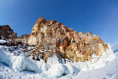 Rocks covered by ice on winter siberian Baikail lake Royalty Free Stock Photos